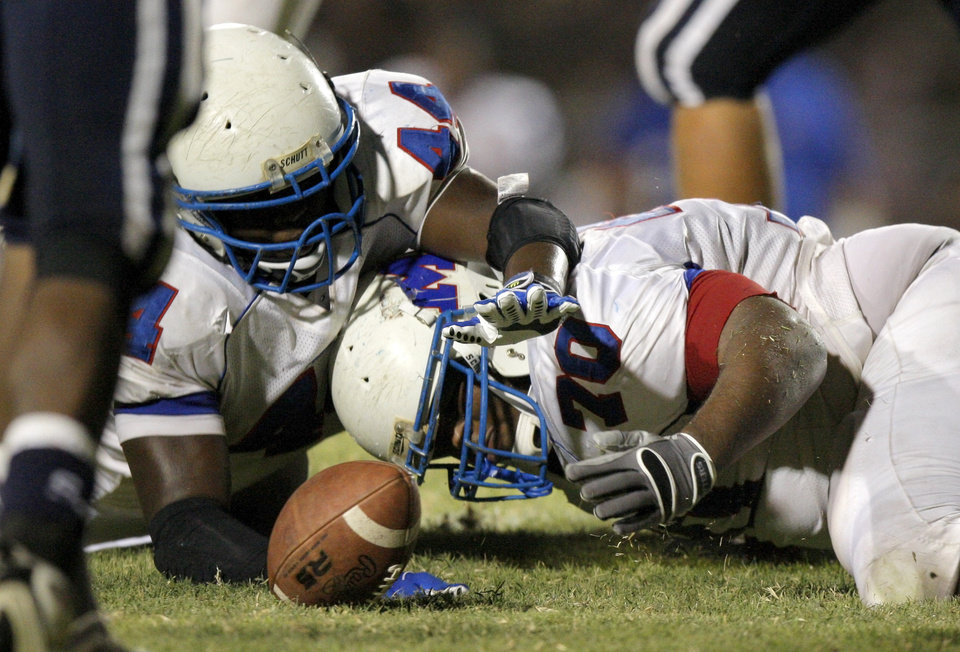 Millwood's Larry Lambeth, left, and Devin Dobbins fight for a loose ball during a high school football game against Star Spencer at Star Spencer in Oklahoma City, Friday, September 2, 2011. Millwood recovered the fumble. Photo by Bryan Terry, The Oklahoman