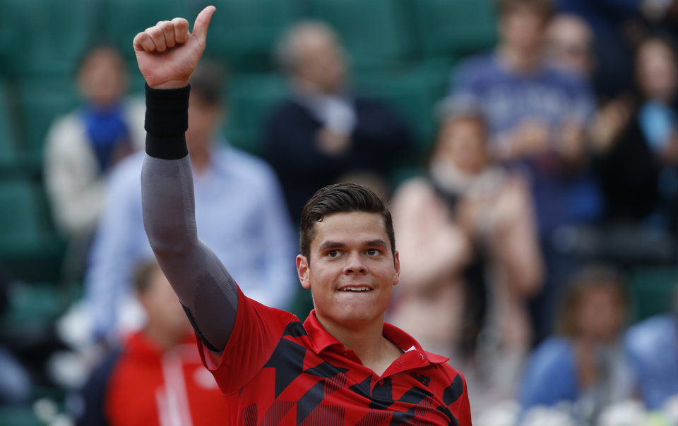Photo - Canada's Milos Raonic celebrates winning the fourth round match of the French Open tennis tournament against Spain's Marcel Granollers at the Roland Garros stadium, in Paris, France, Sunday, June 1, 2014. Raonic won in three sets 6-3, 6-3, 6-3. (AP Photo/Darko Vojinovic)