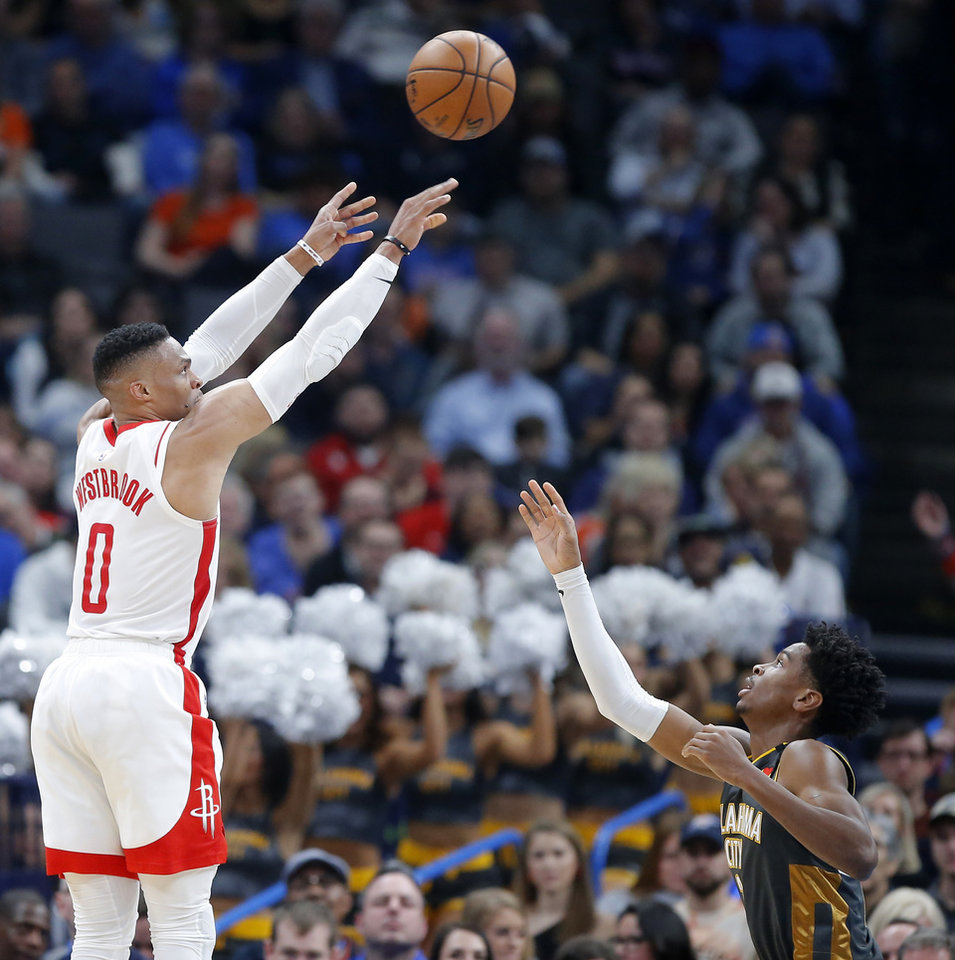 Photo - Houston's Russell Westbrook (0) shoots over Oklahoma City's Shai Gilgeous-Alexander (2) during an NBA basketball game between the Oklahoma City Thunder and Houston Rockets at Chesapeake Energy Arena in Oklahoma City, Thursday, Jan. 9, 2020. [Bryan Terry/The Oklahoman]