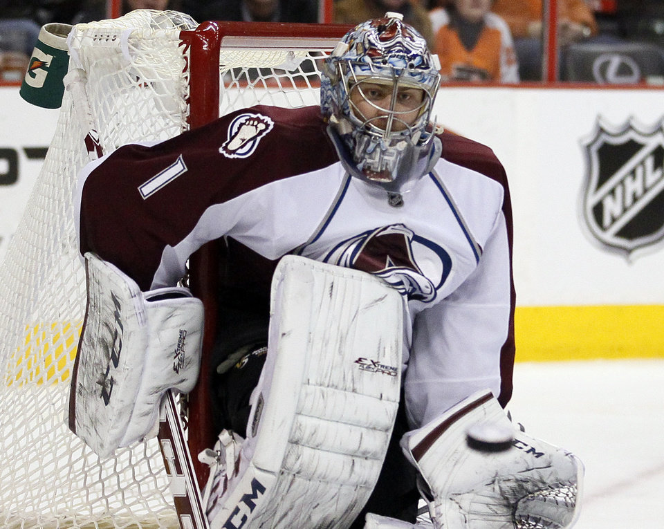 Photo - Colorado Avalanche goalie Semyon Varlamov watches the puck heading to his glove by a shot from Philadelphia Flyers' Brayden Schenn during the second period of an NHL hockey game, Thursday, Feb. 6, 2014, in Philadelphia. (AP Photo/Tom Mihalek)