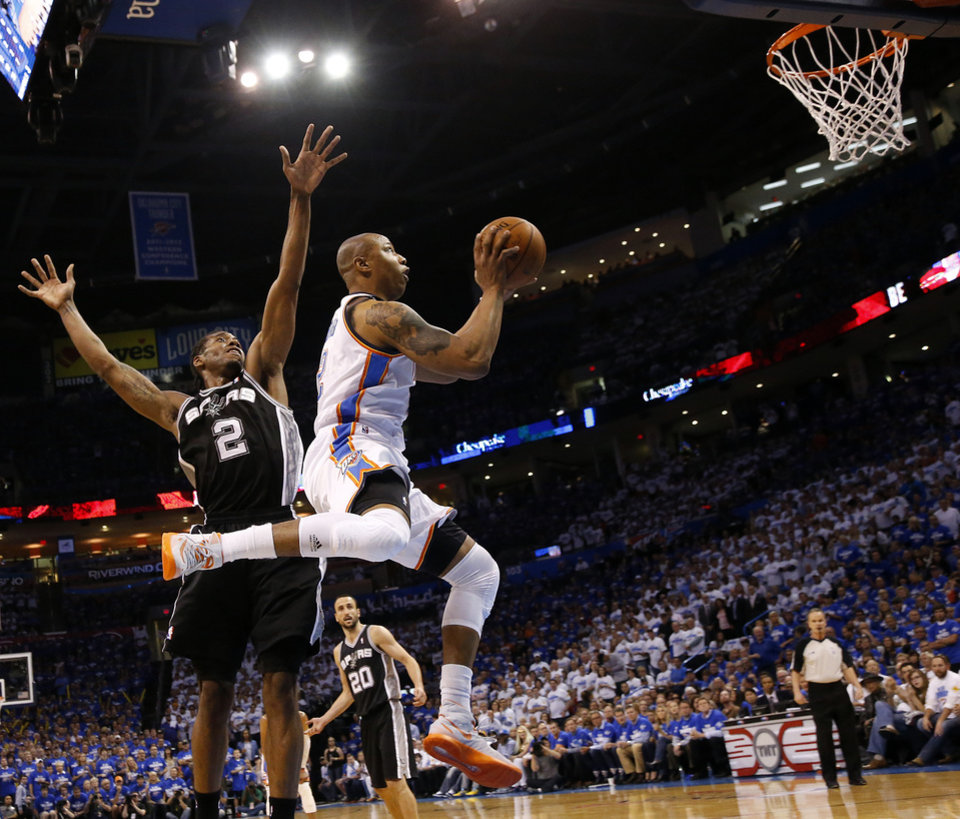 Photo - Oklahoma City's Caron Butler (2) goes to the basket as he his defended by San Antonio's Kawhi Leonard (2) during Game 4 of the Western Conference Finals in the NBA playoffs between the Oklahoma City Thunder and the San Antonio Spurs at Chesapeake Energy Arena in Oklahoma City, Tuesday, May 27, 2014. Photo by Nate Billings, The Oklahoman