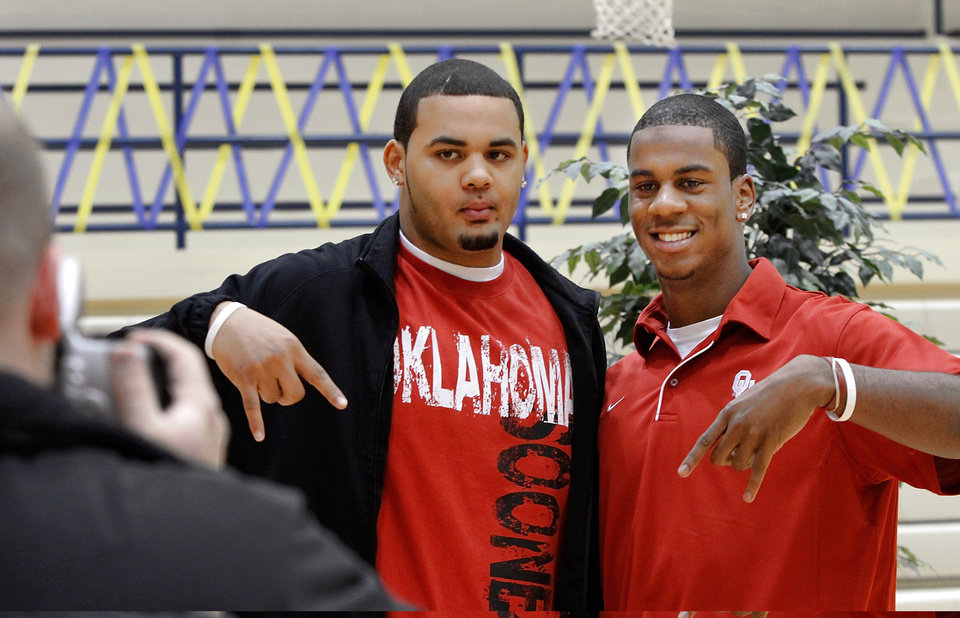 Austin Haywood, left, and teammate Julian Wilson pose for a picture before signing letters of intent with the University of Oklahoma. About a dozen Southmoore High School athletes signed letters of intent with colleges in and out of Oklahoma during a ceremony in the school's gymnasium Wednesday morning, Feb, 3, 2010.  Photo by Jim Beckel, The Oklahoman