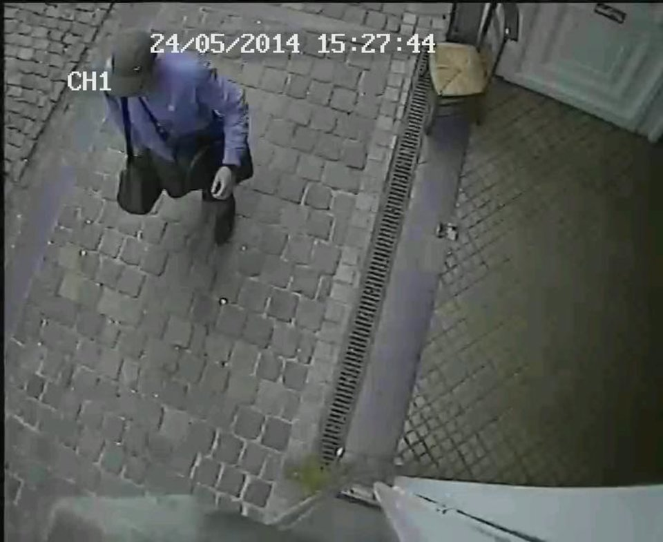 Photo - In this hand out photo distributed on Sunday, May 25, 2014 by the Belgian Federal Police, a surveillance camera shows the suspected killer, walking along, near the Jewish museum in Brussels, Saturday, May 24, 2014. Police stepped up security at Jewish institutions, schools and synagogues after three people were killed and one seriously injured in a spree of gunfire at the Jewish Museum in Brussels on Saturday. (AP Photo/Belgian Federal Police, hand out)