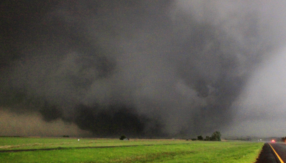 A half-mile-wide tornado moves north Tuesday in Canadian County having just crossed State Highway 3 � the Northwest Expressway � west of SH 4 moving toward Piedmont. Photo by Paul B. Southerland, The Oklahoman