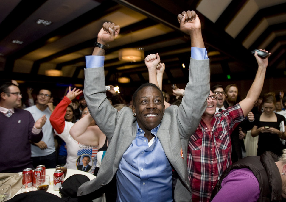 Shanita Harvell   reacts projections reporting the re-election of President Obama during a Democratic Party election party, Tuesday Nov. 6, 2012, in Salt Lake City, Utah. (AP Photo/The Salt Lake Tribune, Kim Raff)