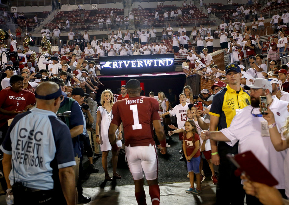 Photo - Oklahoma's Jalen Hurts (1) leaves the field following a college football game between the University of Oklahoma Sooners (OU) and the Houston Cougars at Gaylord Family-Oklahoma Memorial Stadium in Norman, Okla., Sunday, Sept. 1, 2019. [Sarah Phipps/The Oklahoman]