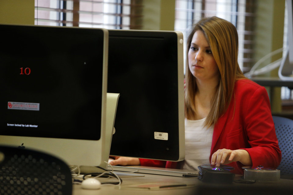 Colleen Owen, Houston sophomore, uses computers and assorted pieces of technology in the Gaylord College of Journalism building Friday at the University of Oklahoma to accompany a story about student technology in Norman. Photo by Steve Sisney, The Oklahoman <strong>STEVE SISNEY</strong>