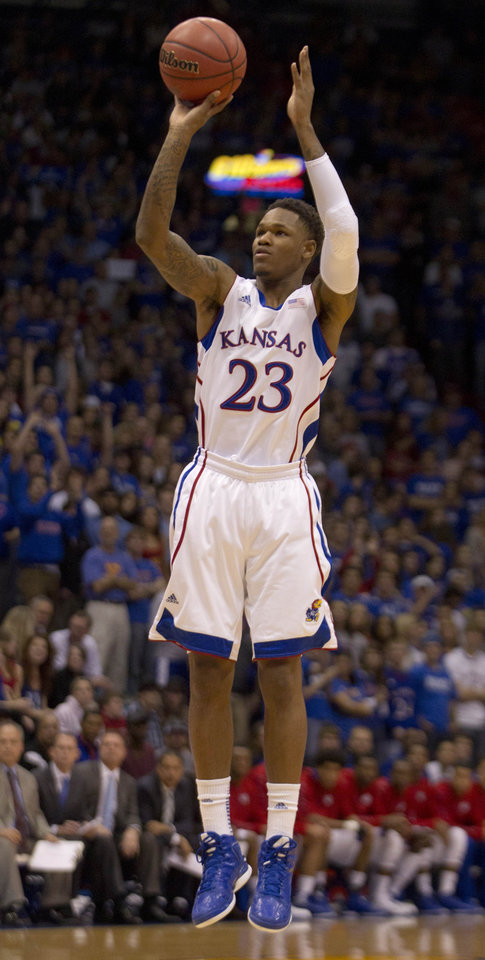 Kansas guard Ben McLemore (23) shoots a three-point basket during the first half of an NCAA college basketball game against Chattanooga in Lawrence, Kan., Thursday, Nov. 15, 2012. (AP Photo/Orlin Wagner)