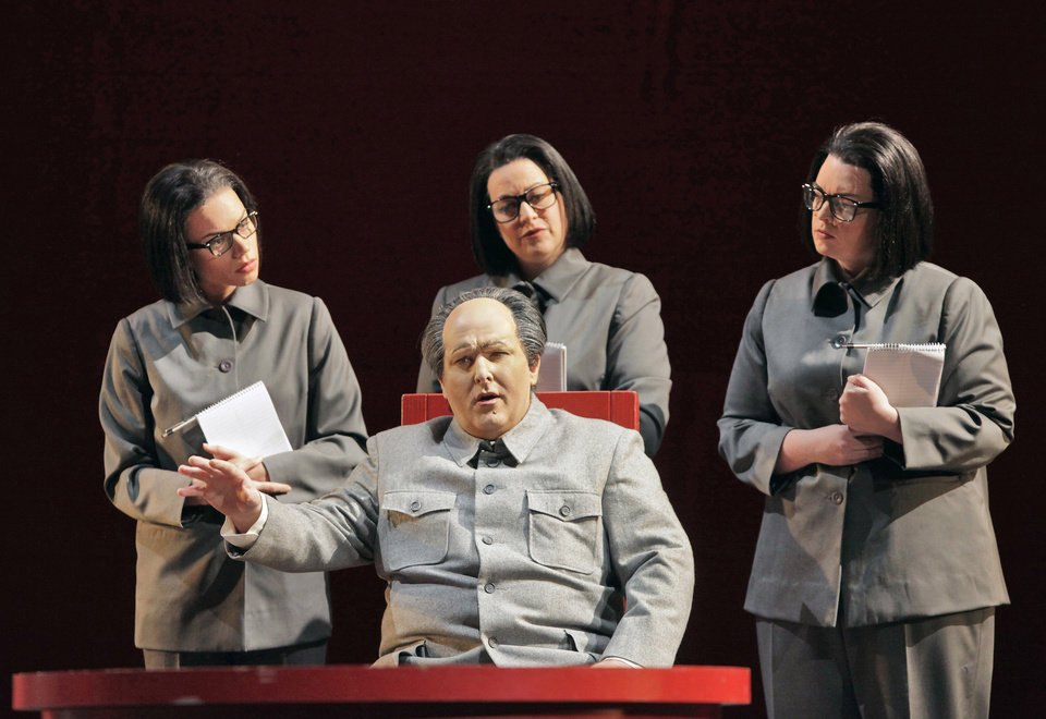 Photo -   In this June 5, 2012 handout photo provided by the San Francisco Opera, Simon O'Neill, as Mao Tse-tung, foreground, is shown with his three secretaries—Ginger Costa Jackson, from left, Buffy Baggott and Nicole Birkland, during a scene from the final dress rehearsal of Nixon in China. The production, increasingly recognized as a modern masterpiece, is finally getting the recognition it deserves on the home ground of composer John Adams, in a sparkling production that highlights the San Francisco Opera's summer season. (AP Photo/San Francisco Opera, Cory Weaver, handout)