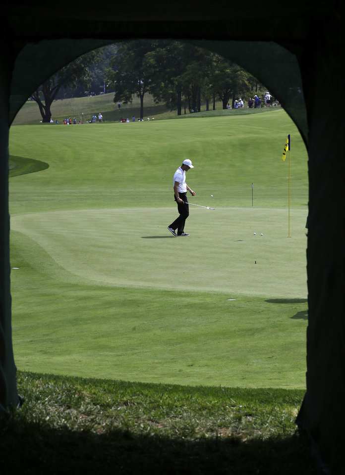 Photo - Martin Kaymer, of Germany, is seen though the players walkway on the 17th hole during a practice round for the PGA Championship golf tournament at Valhalla Golf Club on Tuesday, Aug. 5, 2014, in Louisville, Ky. The tournament is set to begin on Thursday. (AP Photo/David J. Phillip)