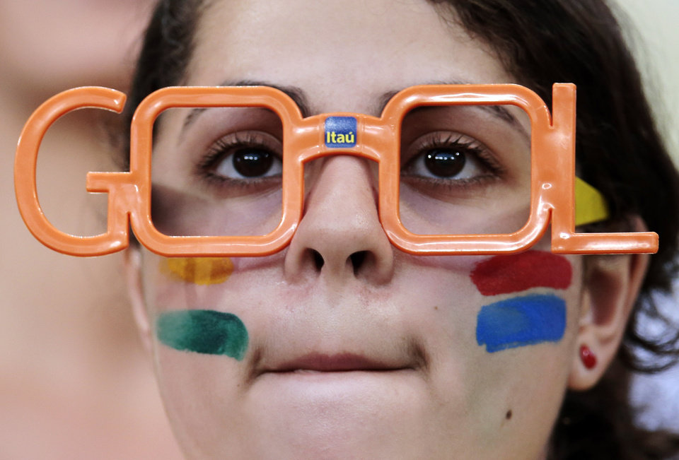 Photo - A spectator waits for the start of the group H World Cup soccer match between Russia and South Korea at the Arena Pantanal in Cuiaba, Brazil, Tuesday, June 17, 2014.  (AP Photo/Ivan Sekretarev)