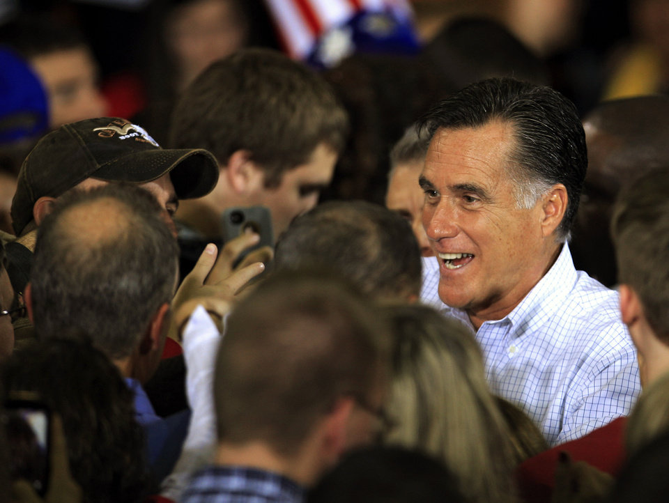 Photo -   Republican presidential candidate and former Massachusetts Gov. Mitt Romney shakes hands with supporters at a campaign event at Avon Lake High School Monday, Oct. 29, 2012, in Avon Lake, Ohio. (AP Photo/Tony Dejak)