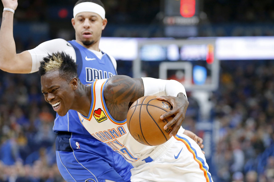 Photo - Oklahoma City's Dennis Schroder (17) goes past Seth Curry (30) of Dallas during an NBA basketball game between the Oklahoma City Thunder and the Dallas Mavericks at Chesapeake Energy Arena in Oklahoma City, Tuesday, Dec. 31, 2019. [Bryan Terry/The Oklahoman]