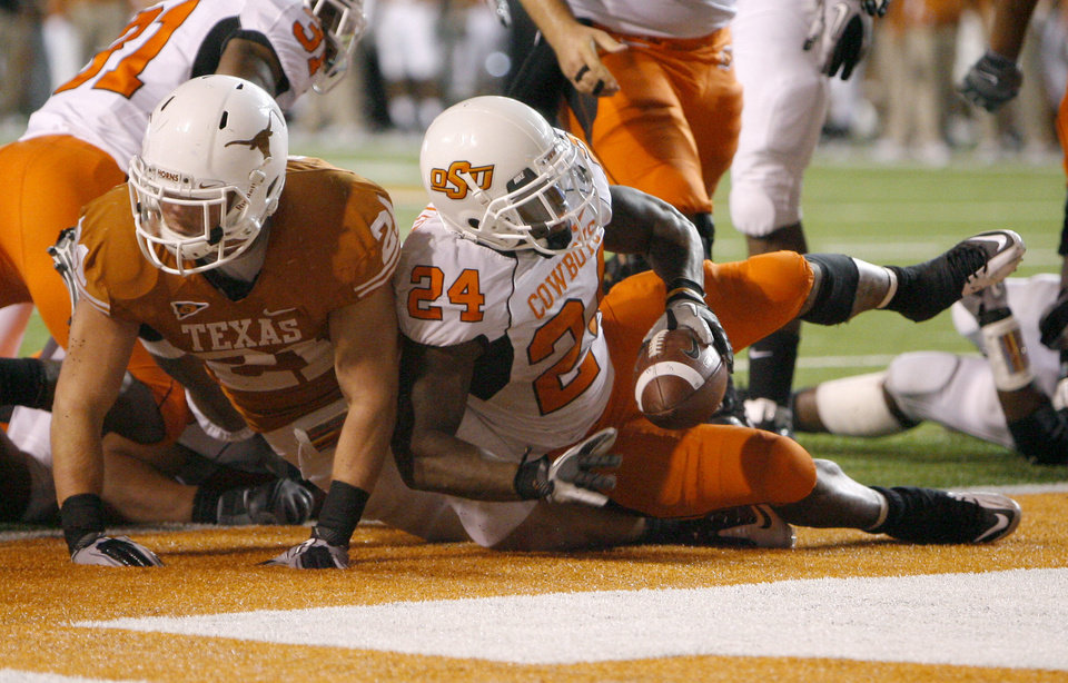 Photo - Oklahoma State's Kendall Hunter (24) scores a touchdown in front of Texas' Blake Gideon (21) during the college football game between the Oklahoma State University Cowboys (OSU) and the University of Texas Longhorns (UT) at Darrell K Royal-Texas Memorial Stadium in Austin, Texas, Saturday, November 13, 2010. Photo by Sarah Phipps, The Oklahoman