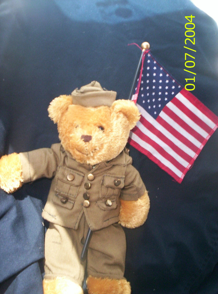 My Teddy Bear to remind me we still need our guys to come home from war.. I drive with him on my dashboard.. He is my flag holder.<br/><b>Community Photo By:</b> Tama<br/><b>Submitted By:</b> Tama, Midwest