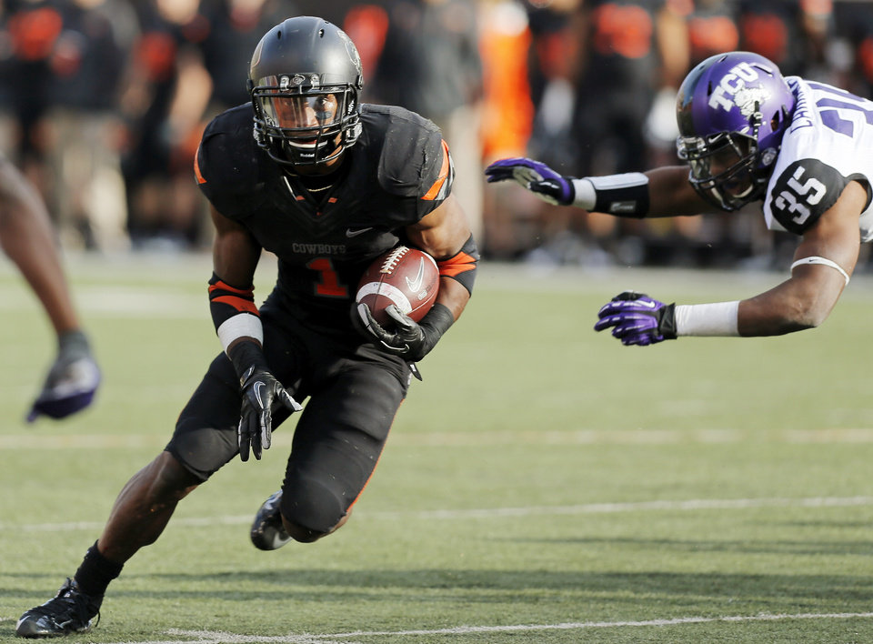 Photo - Oklahoma State's Joseph Randle (1) carries the ball past TCU's Josh Carraway (35) in the third quarter during a college football game between Oklahoma State University (OSU) and Texas Christian University (TCU) at Boone Pickens Stadium in Stillwater, Okla., Saturday, Oct. 27, 2012. OSU won, 36-14. Photo by Nate Billings, The Oklahoman
