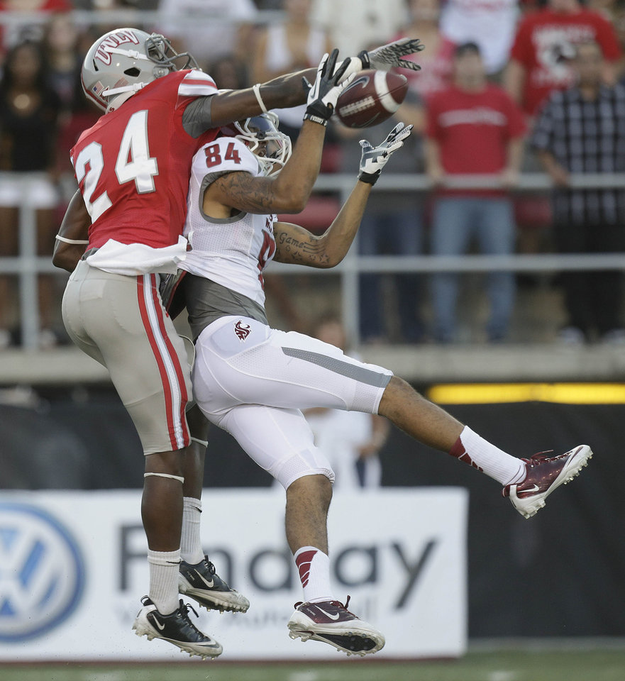 Photo -   Washington State wide receiver Gabe Marks (84) catches a pass against UNLV defensive back Fred Wilson (24) during the first quarter of an NCAA college football game, Friday, Sept. 14, 2012, in Las Vegas. (AP Photo/Julie Jacobson)