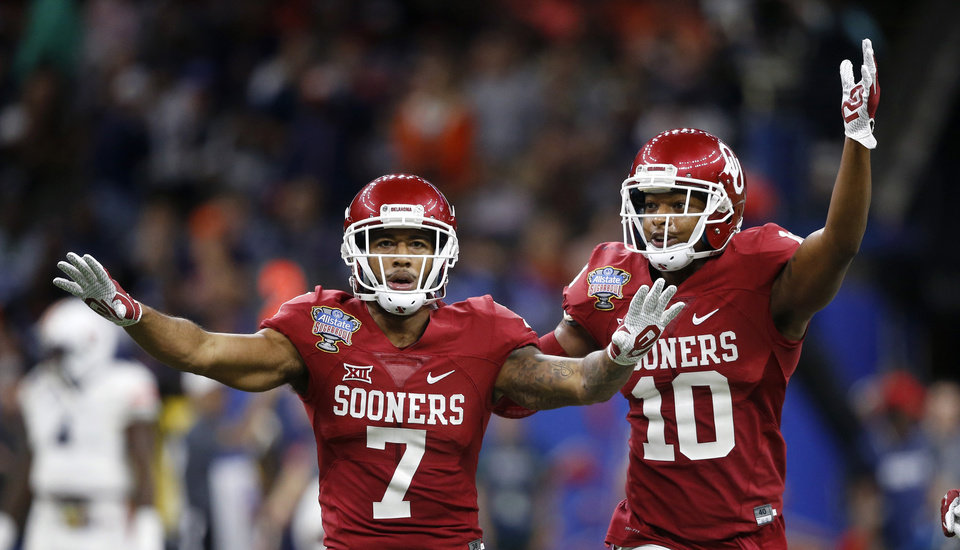 Photo -  Cornerback Jordan Parker (7) and safety Steven Parker (10) helped OU turn into a better secondary by the end of the season. [AP PHOTO]