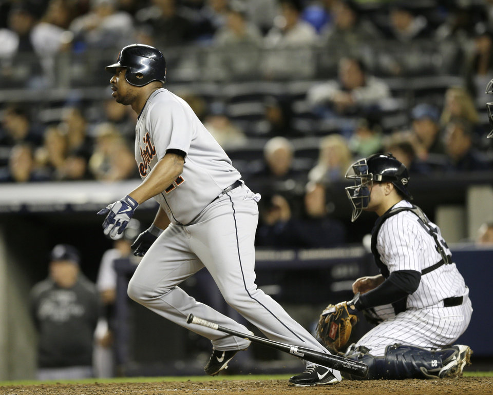 Detroit Tigers designated hitter Delmon Young hits a double, driving in a run, in the 12th inning of Game 1 of the American League championship series early Sunday, Oct. 14, 2012, in New York. New York Yankees catcher Russell Martin is at right. (AP Photo/Matt Slocum)