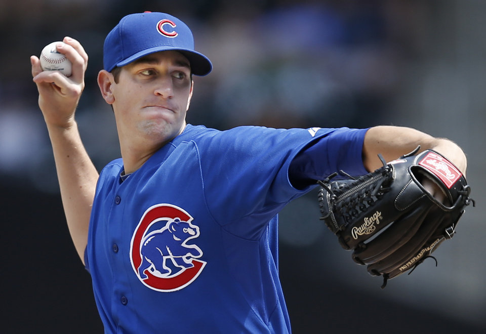 Photo - Chicago Cubs starting pitcher Kyle Hendricks  delivers in a baseball game against the New York Mets at Citi Field in New York, Monday, Aug. 18, 2014. (AP Photo/Kathy Willens)