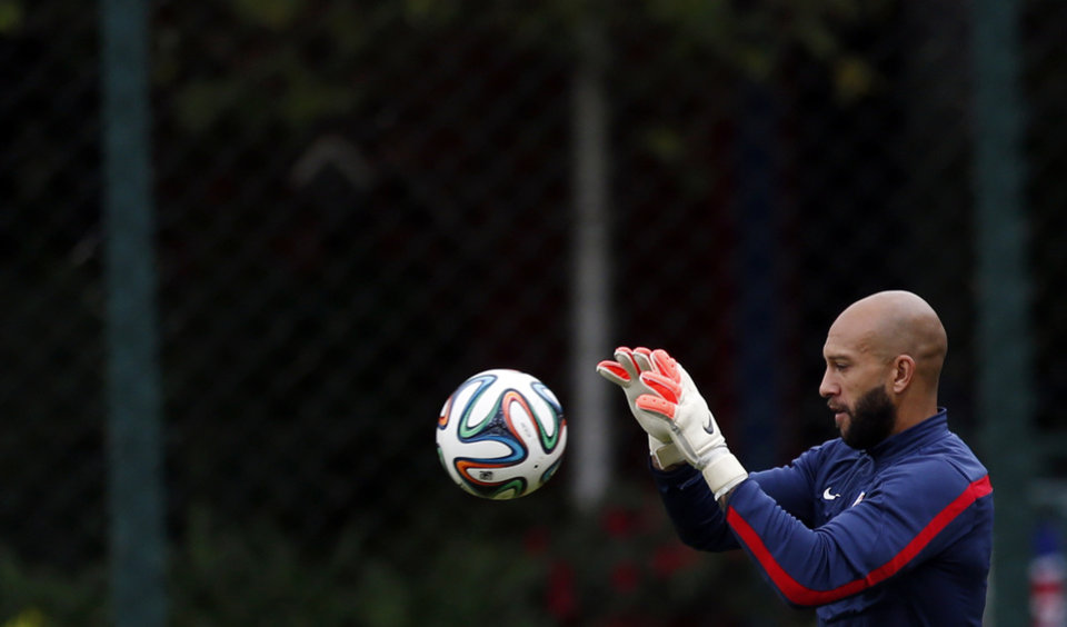 Photo - United States' goalkeeper Tim Howard works out during a training session in Sao Paulo, Brazil, Thursday, June 19, 2014.  The United States will play against Portugal in group G of the 2014 soccer World Cup on June 22. (AP Photo/Julio Cortez)