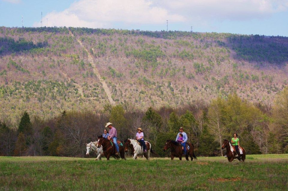 Photo - Visitors to the Buffalo Creek Ranch Talihina in southeastern Oklahoma ride horses. Photo provided