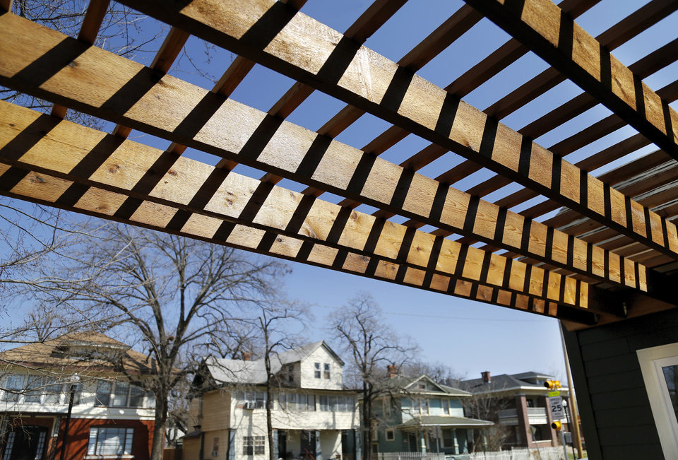 Photo - A pergola is a feature of the front porch of the Positively Paseo house at 1312 NW 16.   PHOTOs BY JIM BECKEL, THE OKLAHOMAN  Jim Beckel -