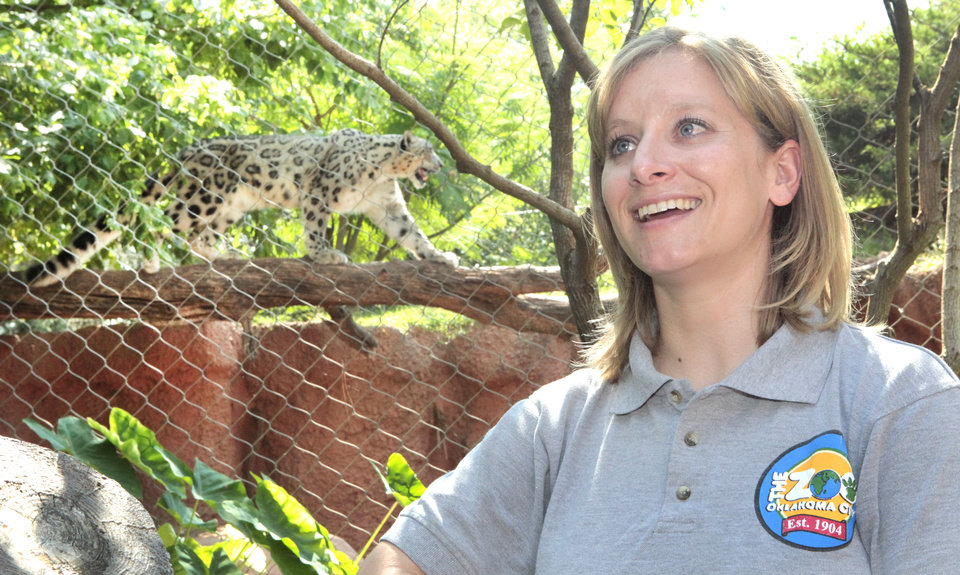 Photo - Jennifer D'Agostino, director of veterinary services at the Oklahoma City Zoo, talked recently about the variances in Oklahoma weather and how the animals adjust to them. Dhirin, a snow leopard, is shown in the background.   David McDaniel - The Oklahoman