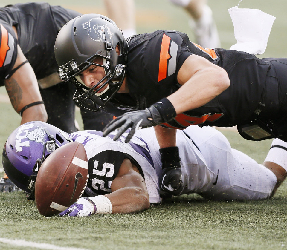 Photo - Oklahoma State's Austin Hays (84) recovers a fumble by Blake Jackson (not pictured) next to TCU's Kevin White (25) in the fourth quarter during a college football game between Oklahoma State University (OSU) and Texas Christian University (TCU) at Boone Pickens Stadium in Stillwater, Okla., Saturday, Oct. 27, 2012. OSU won, 36-14. Photo by Nate Billings, The Oklahoman