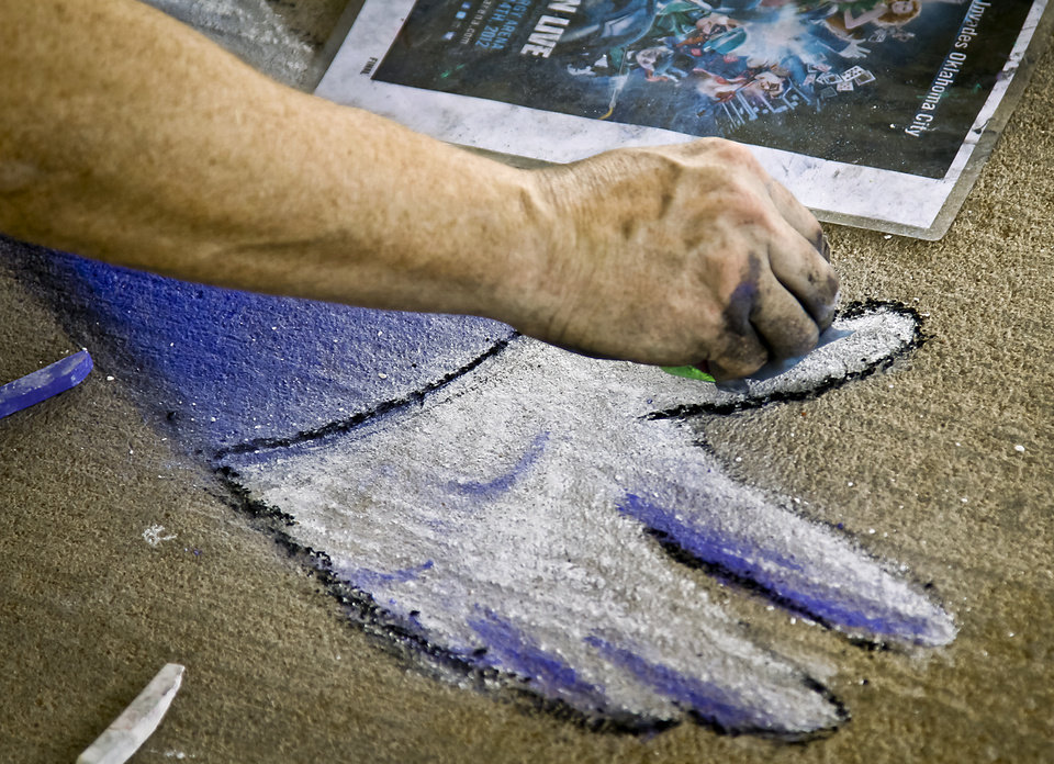 Chalk artist Bobby Marsee works on creation during the sidewalk chalk contest in Downtown Edmond on Friday, June 29, 2012, in Edmond, Oklahoma. Photo by Chris Landsberger, The Oklahoman