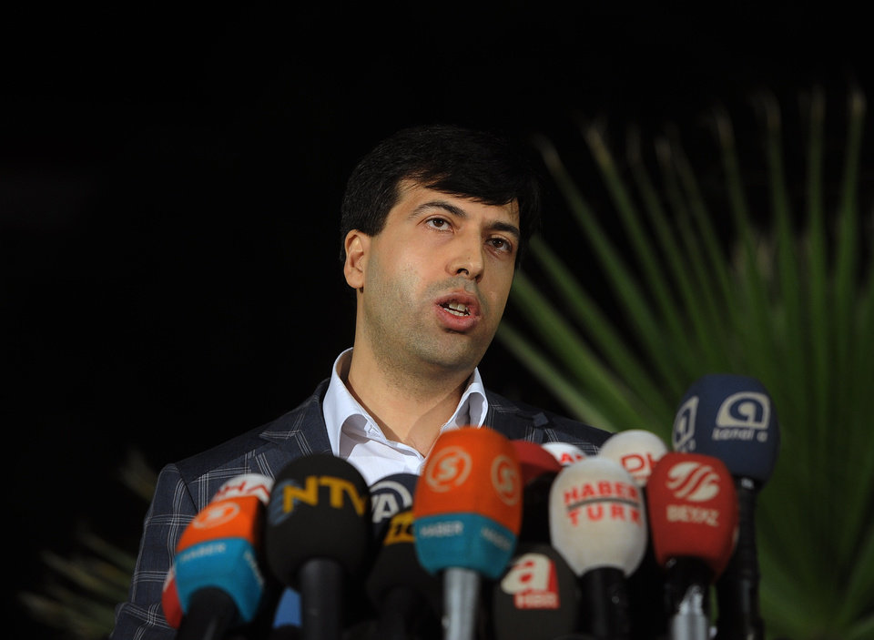 Photo - Chief prosecutor Bekir Sahiner speaks to the media in the coal miners' town of Soma, Turkey, Sunday, May 18, 2014. Twenty-five people, including mining company executives, have been detained as Turkish officials investigate the mining disaster that killed 301 people, a domestic news agency reported Sunday.(AP Photo/Emre Tazegul)