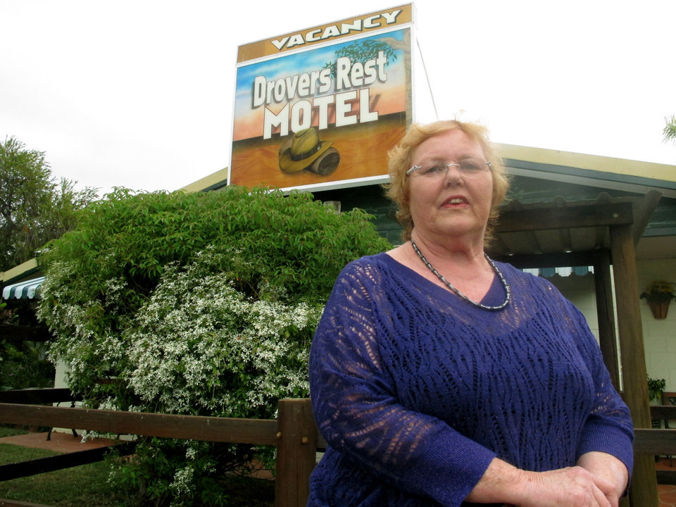 Photo - In this photo taken on Thursday, June 13, 2013, Joan Hartley poses outside the motel she owns in Moranbah, Australia. Drovers Rest Motel was at the center of a test case over whether sex workers could be refused rooms. They are increasingly facing restrictions on their ability to work in Australia's two main mining states. (AP Photo/Rod McGuirk)