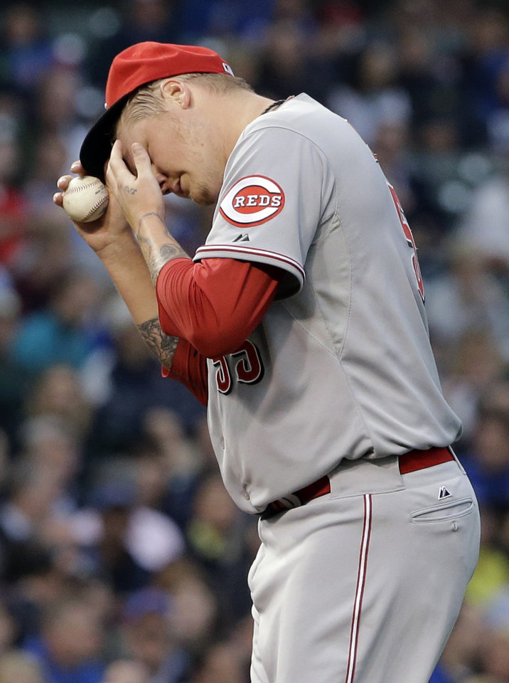 Photo - Cincinnati Reds starter Mat Latos wipes his face after Chicago Cubs' Luis Valbuena hit a single during the fourth inning of a baseball game in Chicago, Wednesday, June 25, 2014. (AP Photo/Nam Y. Huh)