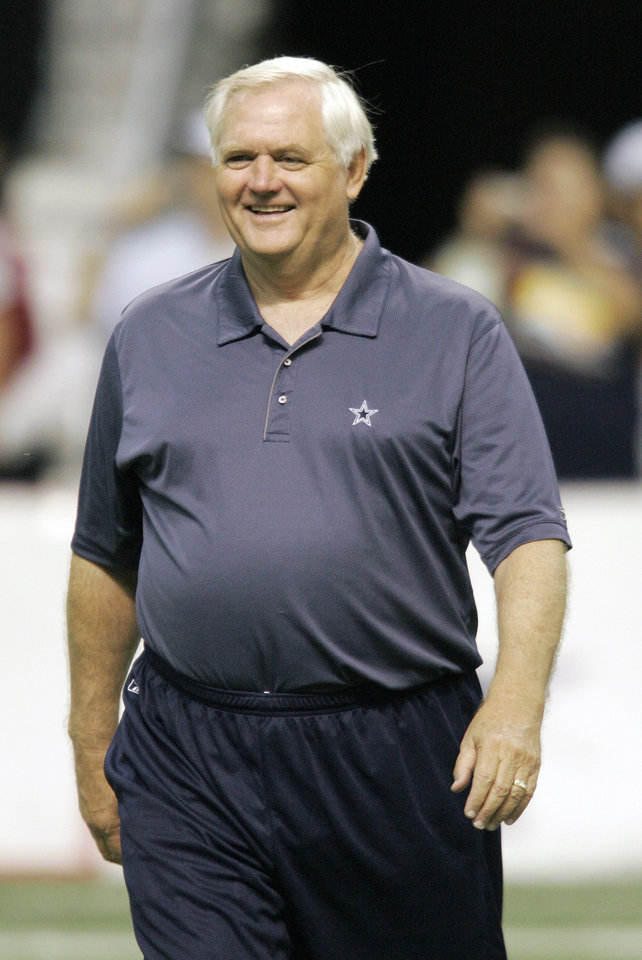 Photo - NFL FOOTBALL: Dallas Cowboys coach Wade Phillips smiles during football training camp in San Antonio, Monday, July 30, 2007.  (AP Photo/Eric Gay) ORG XMIT: TXEG103