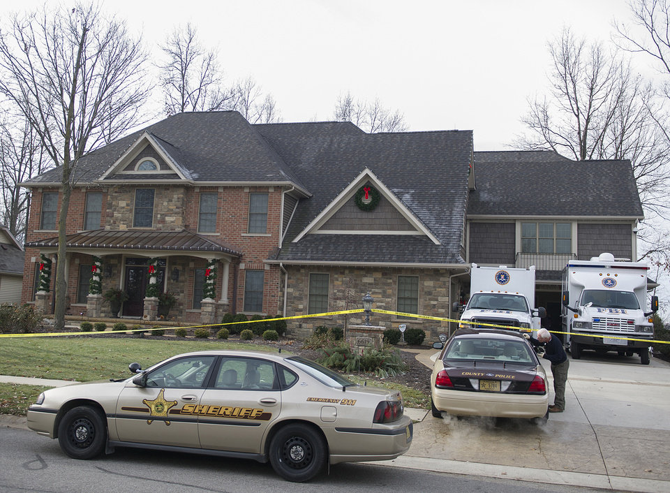 The FBI and local law enforcement search the home of Michael Fabini, brother of National Football League player Jason Fabini, Thursday,  Dec. 6, 2012 at Cherry Hill Parkway in Fort Wayne, Ind.  Federal, state and local officers with the Safe Streets Task Force raided a Fort Wayne property owned by Jason Fabini, a home owned by his brother, Michael Fabini, and five other area properties Thursday.  FBI Special Agent David Crawford declined Friday, Dec. 7, 2012,  to say why the properties were raided, saying only that there was �investigative activity� going on there. The task force focuses on combatting illegal drugs and violent crime.  (AP Photo/The Journal Gazette, Swikar Patel) MANDATORY CREDIT