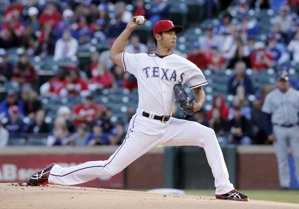 Photo - Texas Rangers starting pitcher Yu Darvish throws during the first inning of a baseball game against the Seattle Mariners, Wednesday, April 16, 2014, in Arlington, Texas. (AP Photo/Brandon Wade)
