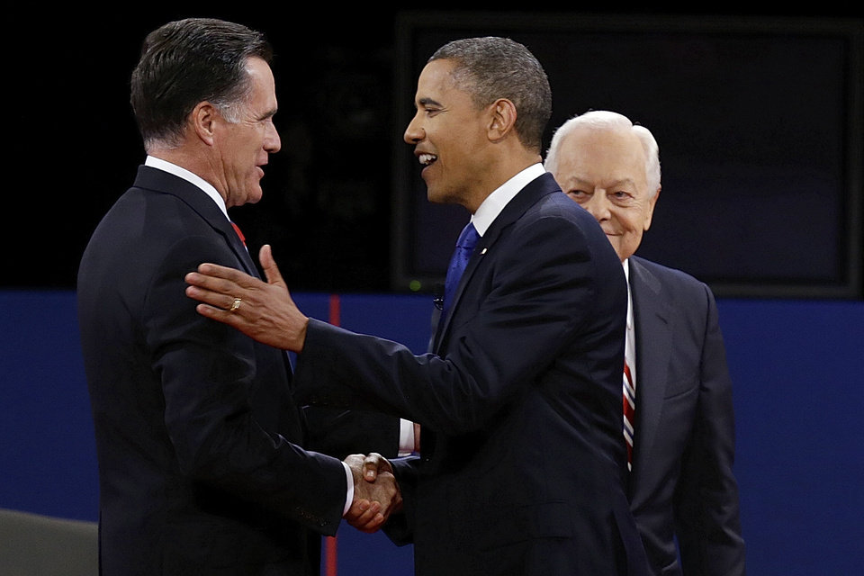 Photo -   Republican presidential nominee Mitt Romney and President Barack Obama shake hands as moderator Bob Schieffer looks on during the third presidential debate at Lynn University, Monday, Oct. 22, 2012, in Boca Raton, Fla. (AP Photo/Charlie Neibergall)