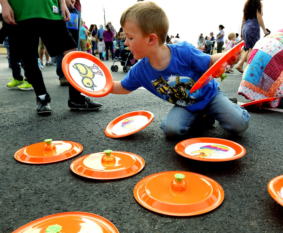 Damien Sanders, 4, from Tecumseh, plays a memory game at the Cleveland County YMCA Community Easter Egg Hunt on Saturday, March 30, 2013 in Norman, Okla.  Photo by Steve Sisney, The Oklahoman