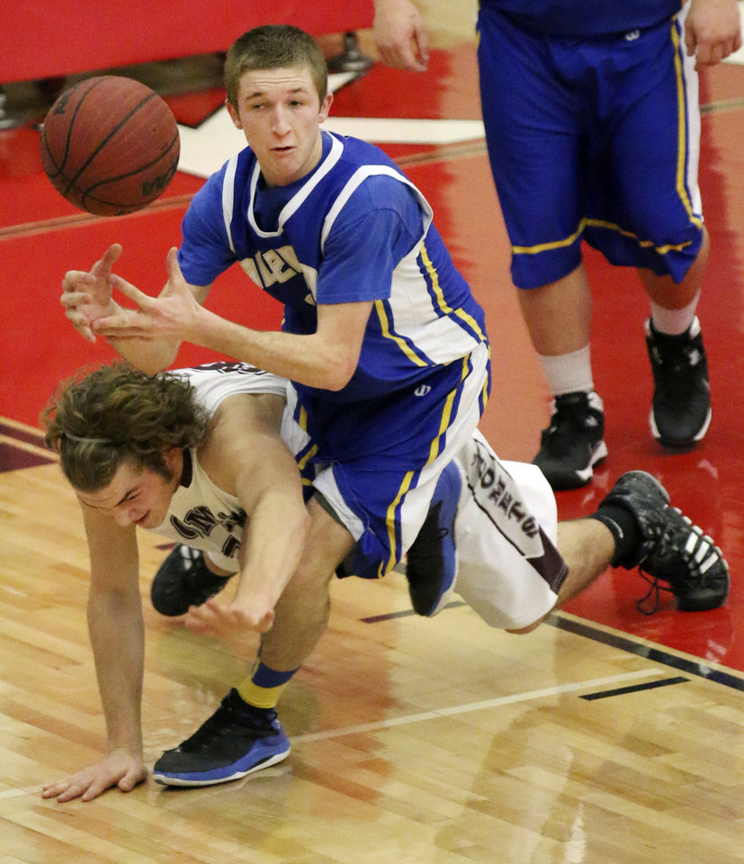 Photo - Velma-Alma's Jake McGuire hits the court as he battles Glencoe's Sean Smith for a loose ball during their Class A Boys quarterfinal game at Yukon High School, Thursday March 6, 2014. Photo By Steve Gooch, The Oklahoman