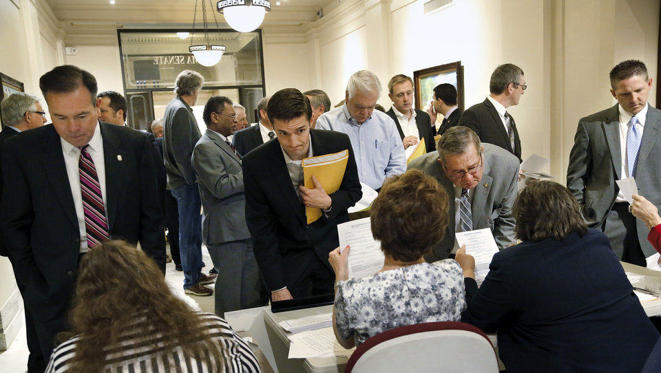 Photo -  Candidates line up to file papers with election officials Wednesday at the state Capitol. It was first first day of the candidate filing period that runs through 5 p.m. Friday. PHOTOS BY JIM BECKEL, THE OKLAHOMAN  Jim Beckel -
