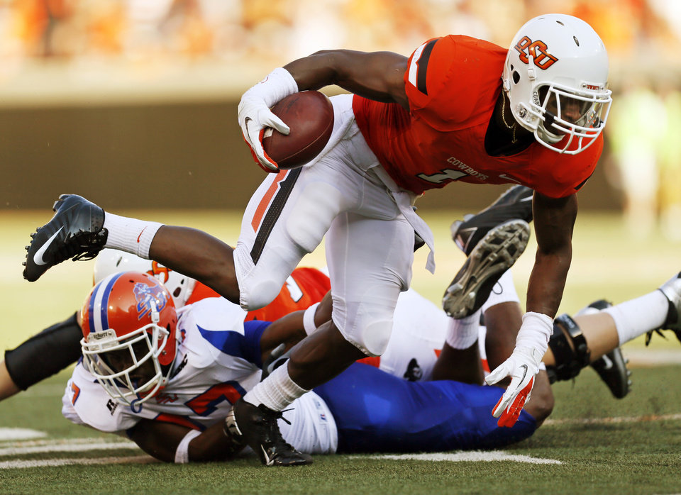 Photo - OSU's Joseph Randle (1) carries the ball in the first quarter during a college football game between Oklahoma State University (OSU) and Savannah State University at Boone Pickens Stadium in Stillwater, Okla., Saturday, Sept. 1, 2012. Photo by Nate Billings, The Oklahoman