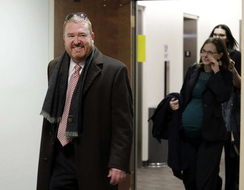Photo - Defense attorney Daniel King leads his team to court for a hearing for Aurora theater shooting suspect James Holmes at the courthouse in Centennial, Colo., on Friday, Jan. 11,  2013. (AP Photo/Ed Andrieski)