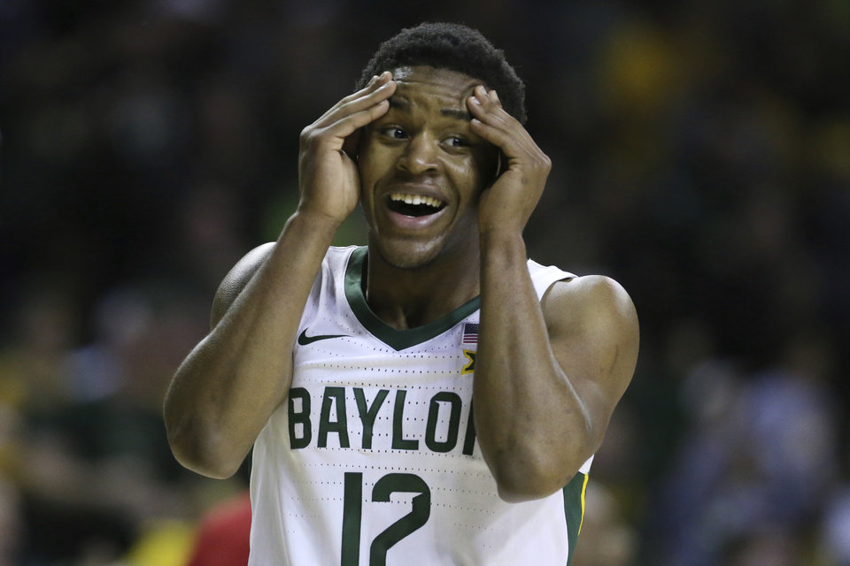Photo - Baylor guard Jared Butler reacts to a score against West Virginia in the first half of an NCAA college basketball game, Saturday, Feb. 15, 2020, in Waco, Texas. (AP Photo/Rod Aydelotte)