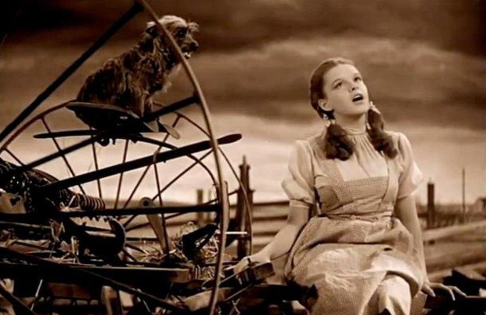 """Photo -  Dorothy, portrayed by Judy Garland, sings the iconic song """"Over the Rainbow"""" as her dog Toto looks in in this scene from the movie classic """"The Wizard of Oz."""" Photo provided"""