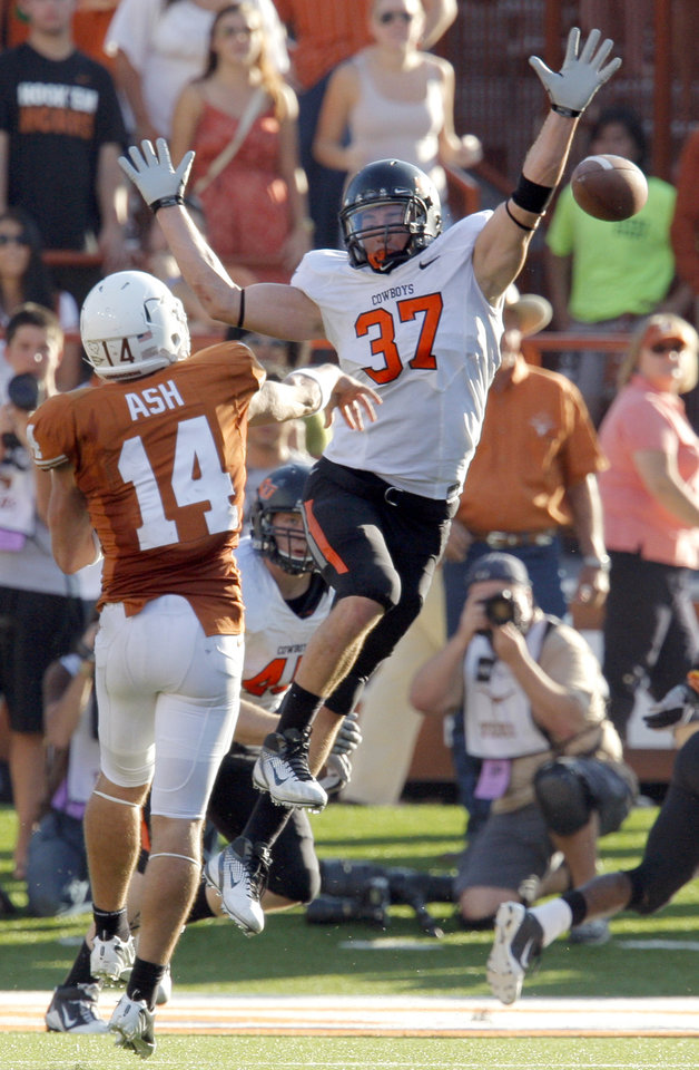 Oklahoma State's Alex Elkins (37) pressures Texas' David Ash (14) during second half of a college football game between the Oklahoma State University Cowboys (OSU) and the University of Texas Longhorns (UT) at Darrell K Royal-Texas Memorial Stadium in Austin, Texas, Saturday, Oct. 15, 2011. Photo by Sarah Phipps, The Oklahoman  ORG XMIT: KOD