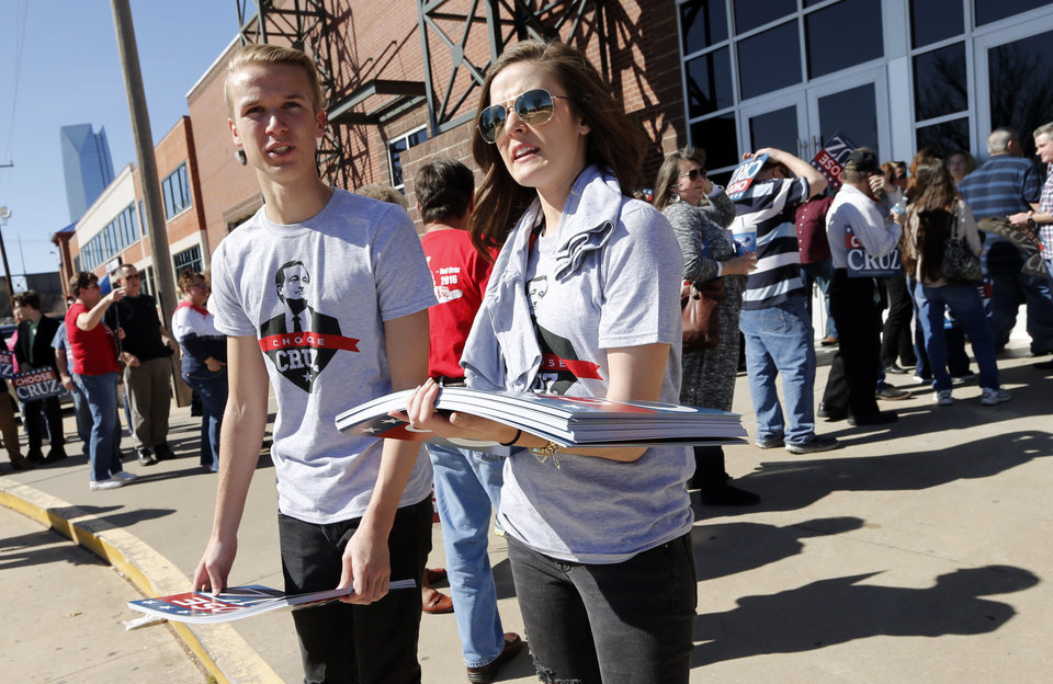 Photo - Wes Engle and sister Victoria, Durant, pass out Cruz Signs outside the Chevy Bricktown Event Center as Republican presidential candidate Ted Cruz is scheduled to speak as part of the Oklahoma City Courageous Conservatives Rally on Sunday, Feb. 28, 2016 in Oklahoma City, Okla.  Photo by Steve Sisney, The Oklahoman