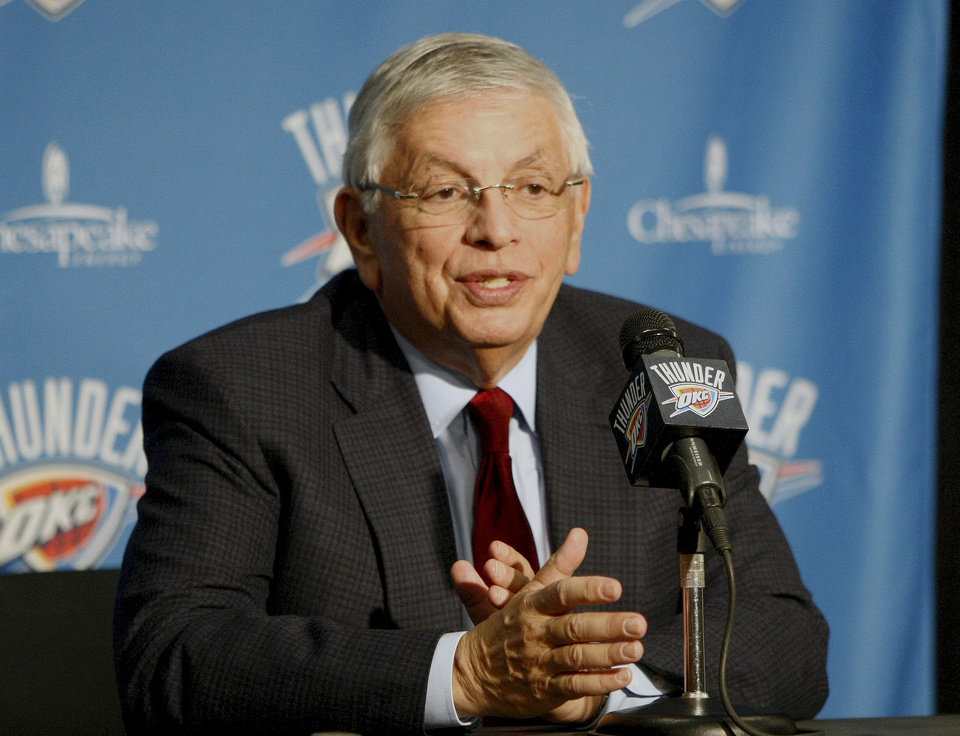 Photo - NBA Commissioner David Stern speaks to reporters before the start of an NBA basketball game in Oklahoma City between the Oklahoma City Thunder and Orlando Magic, Sunday, Dec. 25, 2011. (AP Photo/Alonzo Adams) ORG XMIT: OKAA102