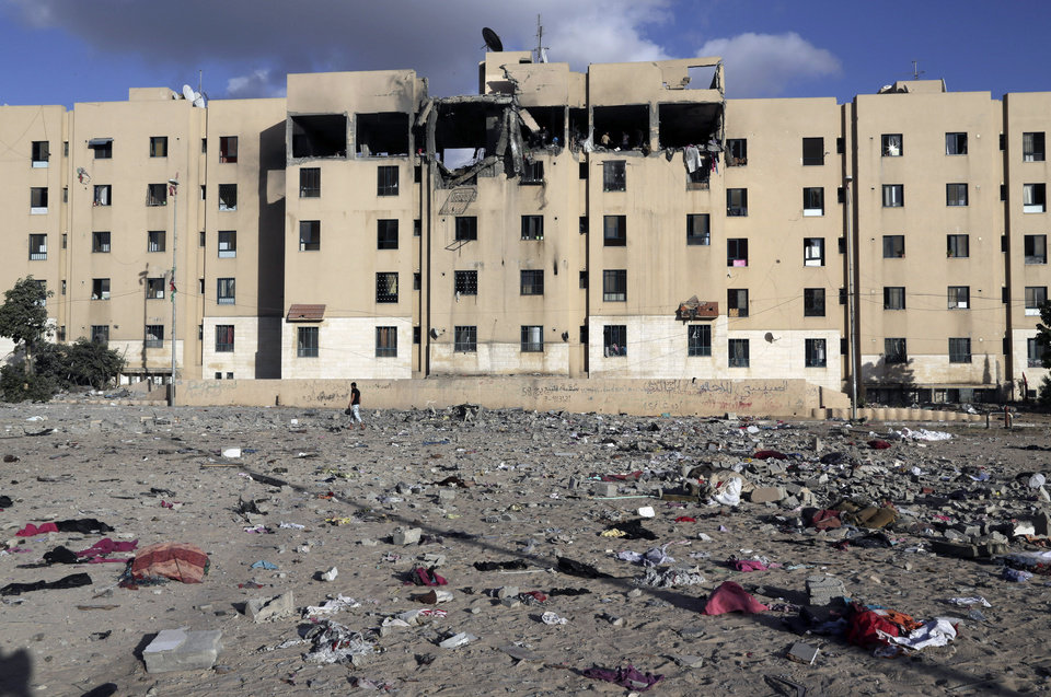 Photo - Debris lies scattered at the scene of a damaged apartment block after it was hit by an Israeli airstrike in Beit Lahiya, northern Gaza Strip, Tuesday, July 15, 2014. The Israeli military says it has resumed airstrikes on Gaza after Hamas militants violated a de-escalation brokered by Egypt. (AP Photo/Adel Hana)