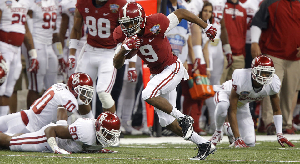 Photo - Alabama's Amari Cooper (9) gets past the Oklahoma defense during the NCAA football BCS Sugar Bowl game between the University of Oklahoma Sooners (OU) and the University of Alabama Crimson Tide (UA) at the Superdome in New Orleans, La., Thursday, Jan. 2, 2014.  .Photo by Chris Landsberger, The Oklahoman