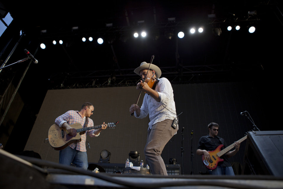 Photo - The Josh Abbott band perform a set at OKC Fest in downtown Oklahoma City on Friday, June 27, 2014. OKC Fest is a new two day country music festival with multiple stages downtown. Photos by Nathan Poppe/The Oklahoman